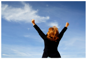 Image of a successful business-woman, with her arms in the air