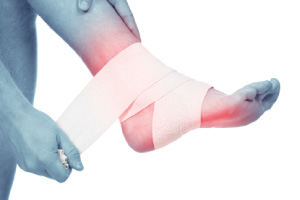 Image of someone taping their injured foot