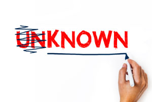 Photo of someone changing the word unknown to known - as a metaphor for having a strong personal career brand