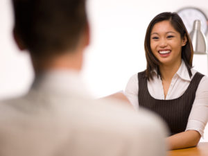Picture of a woman smiling with confidence in a job interview
