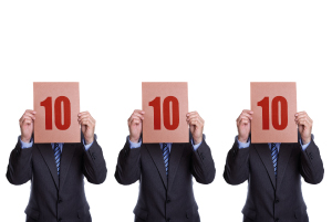 3 men holding up signs awarding 10 out of 10 - illustrating the idea of a perfect career