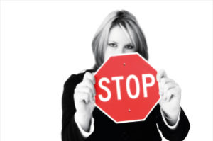 Business woman holding a stop sign