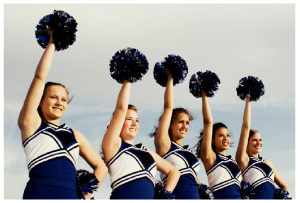 Picture of cheerleaders, cheering someone on