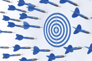Picture of multiple darts missing a target board
