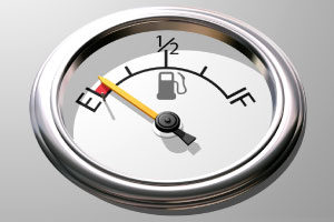 Photo of a fuel gauge, with the needle pointing to empty