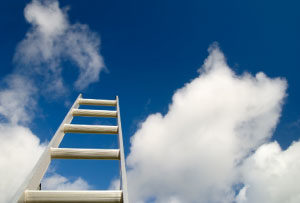Photo of a ladder into the sky, as a metaphor for promotion on a career ladder