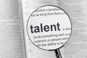 Magnifying glass over the word 'talent' in a dictionary (related to career strengths and skills)